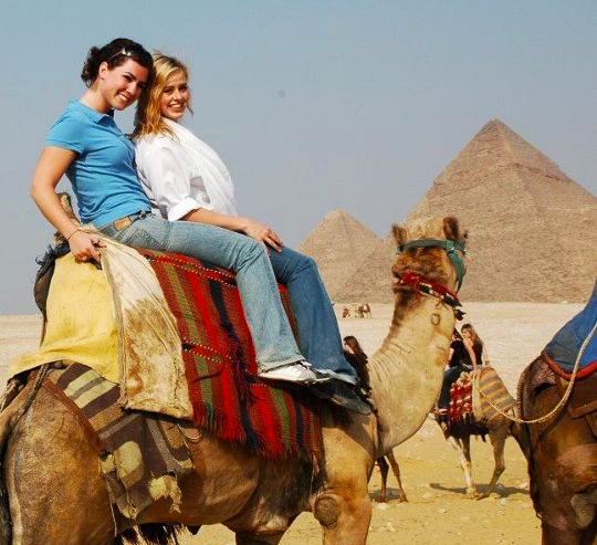 A travel picture of Bridget Nielsen on a camel in Egypt