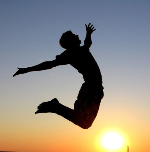 man jumping for joy showing that following our excitement shows us the path