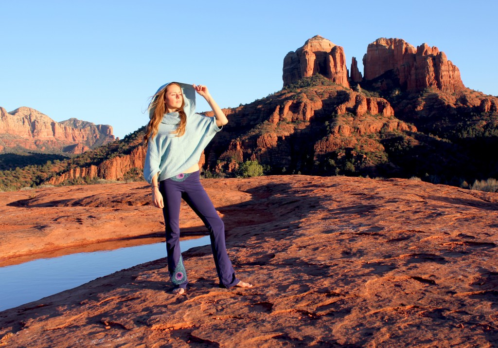 Girl in yoga clothes on the red rocks in Sedona
